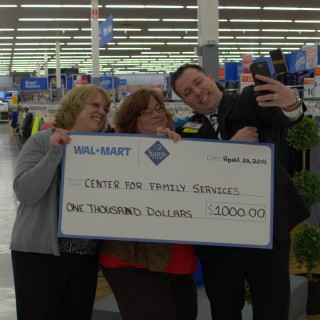 Maria getting a selfie a couple of the WalMart crew.
