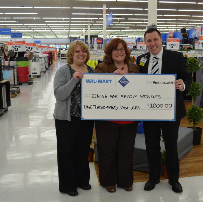 Maria Firkaly is presented the $1000 donation from Meadville Walmart.